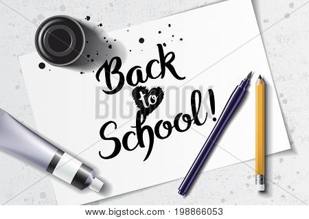 Welcome Back to School handdrawn lettering with calligraphy mockup with brush pen, sharp pencil, paint tube and black ink bottle on the background of white sheet of paper and grunge table