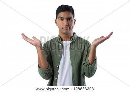 Portrait of frowning man gesturing against white background