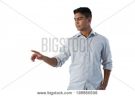Man pretending to touch an invisible screen against white background