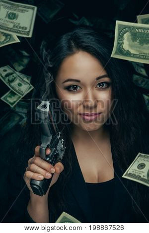 Sexy robber woman with pistol
