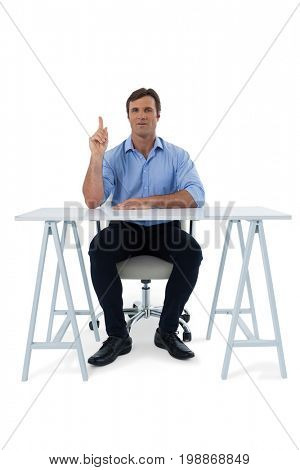 Male executive pressing an invisible virtual screen against white background