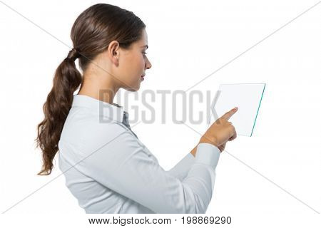 Smiling female executive using a glass digital tablet