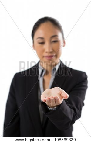 Female executive holding invisible object against white background