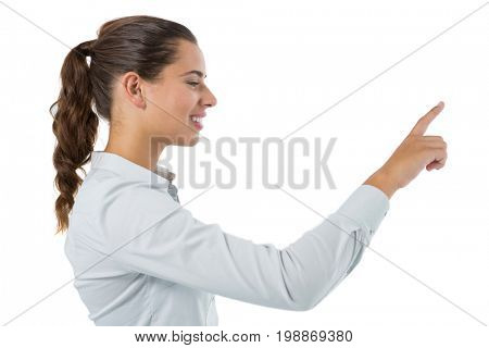Female executive pressing an invisible virtual screen against white background