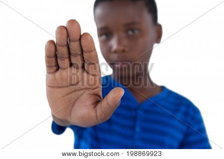 Portrait of cute boy showing his hand while ignoring