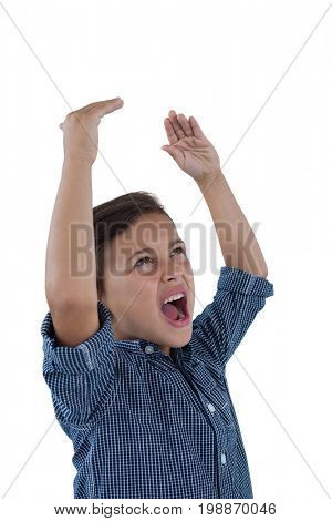 Cute boy shouting against white background