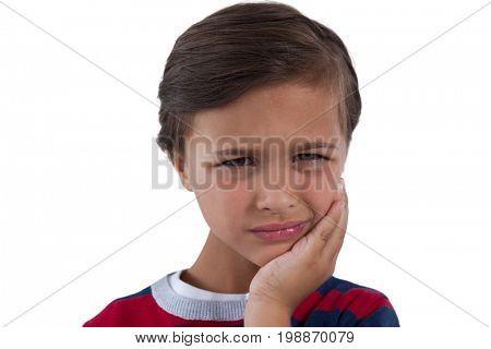 Close-up of cute boy having an toothache