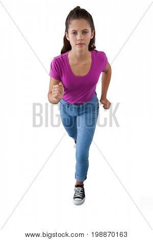 Portrait of girl running against white background