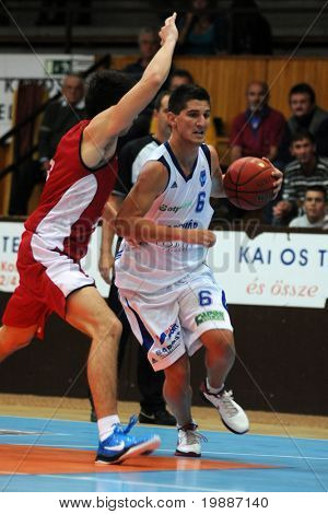 KAPOSVAR, HUNGARY - SEPTEMBER 7: Unidentified players in action at a friendly basketball game Kaposvar (HUN) vs Bosna KK Sarajevo (BIH) September 7, 2010 in Kaposvar.