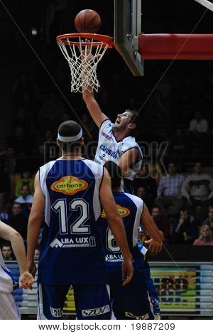 KAPOSVAR, HUNGARY - FEBRUARY 7: Laszlo Orosz (in white) in action at a Hugarian Cup basketball game Kaposvar vs. Albacomp February 7, 2007 in Kaposvar, Hungary.