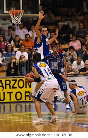 SZEKESFEHERVAR, HUNGARY - FEBRUARY 10: Unidentified players in action at a Hugarian Champonship basketball game Albacomp vs. Kaposvar February 10, 2007 in Szekesfehervar, Hungary.