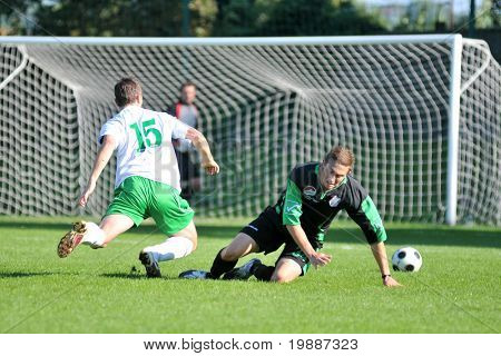 KAPOSVAR, HUNGARY - SEPTEMBER 5: Daniel Konya (L) in action at a Hungarian National Championship III. soccer game Kaposvar II. vs. Nagyatad September 5, 2010 in Kaposvar, Hungary.