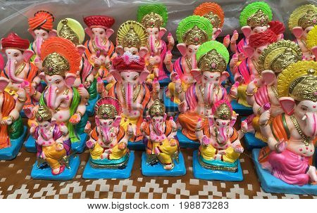 Many hand crafted Ganesha idol statues displayed in a shop during Ganesh Festival.