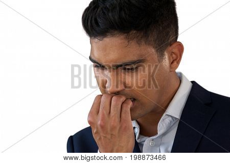 Close up of worried businessman biting nails against white background