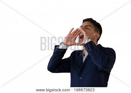 Businessman with hands covering mouth shouting while standing against white background