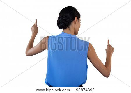 Businesswoman in sleeveless clothing pointing on interface against white background