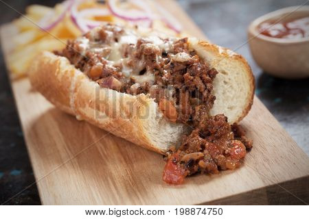 Sloppy joes ground beef sandwich served with onion and french fries