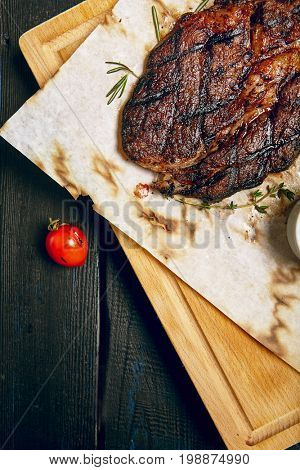 Gourmet Grill Restaurant Steak Menu - Rib Eye Beef Steak on Wooden Background. Black Angus Prime Beef Steak. Beef Steak Dinner. Top VIew
