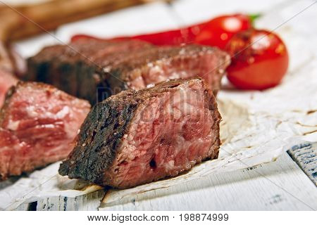 Gourmet Grill Restaurant Beef Steak Menu - Denver Cut Steak on Wooden Background. Black Angus Beef Steak. Beef Steak Dinner