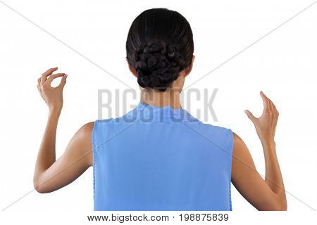 Rear view of businesswoman gesturing while standing against white background