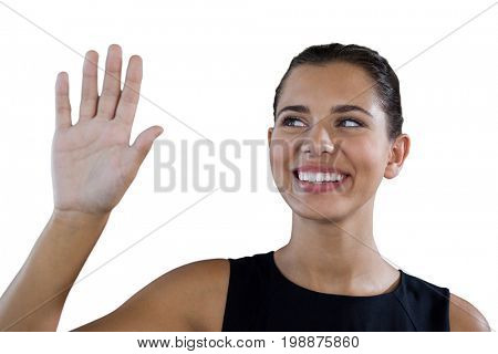 Close up of happy businesswoman touching invisible interface against white background