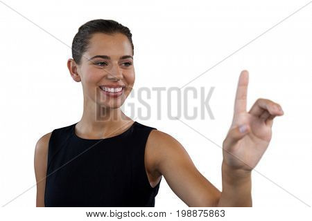 Close up of smiling businesswoman touching invisible interface against white background