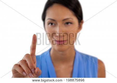 Close up of businesswoman touching interface against white background
