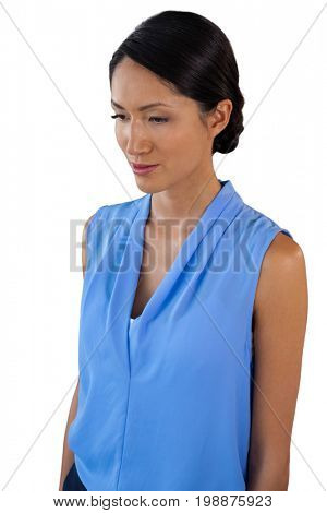 Contemplated businesswoman woman looking down while standing against white background