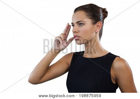 Close up of thoughtful businesswoman gesturing while looking away against white background