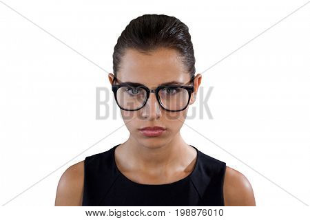Portrait of serious young businesswoman wearing eyeglasses against white background