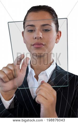 Close up of young businesswoman using glass interface against white background