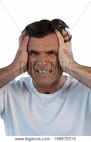 Close up portrait of mature man suffering from headache against white background