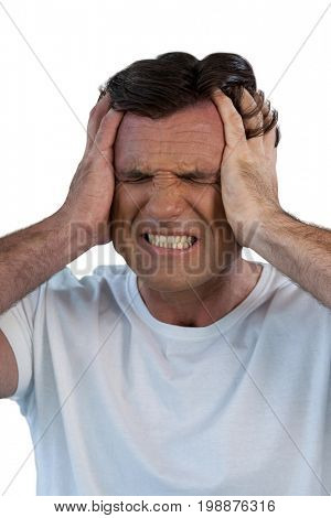 Mature man suffering from headache against white background