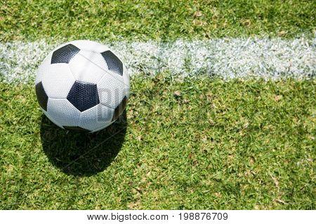 Higha angle view soccer ball on field