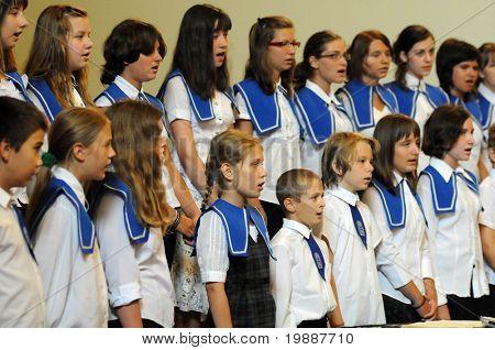 KAPOSVAR, HUNGARY - AUGUST 26: Members of the Marianum Komarno Choir sing at the IV. Pannonia Cantat Youth Choir Festival August 26, 2010 in Kaposvar, Hungary