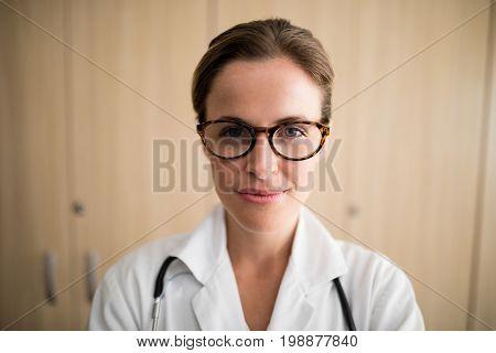 Close-up of smiling female practitioner wearing eyeglasses at nursing home