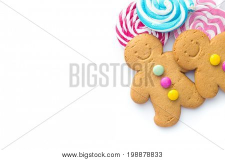 Two sweet gingerbread men and lollipops isolated on white background. Xmas gingerbread. Laughing gingerbread man.