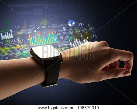 Cloe up naked female hand with smartwatch with financial symbols around