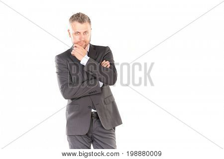Portrait of middle-aged businessman in elegant suit posing against white background