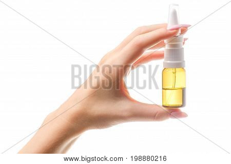 Spray for nose in female hand on white background Isolation