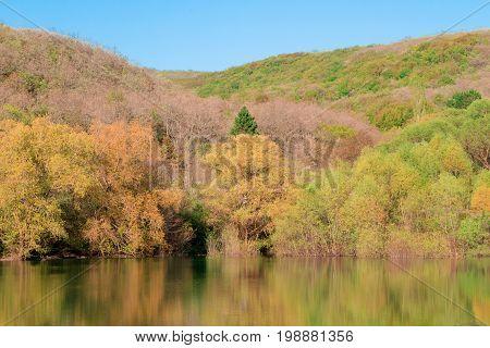 Autumn nature of the Crimea is a beautiful. Mountain lake in autumn Sevastopol.