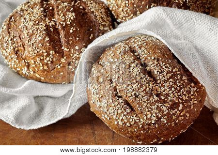 Closeup of wholemeal bread loafs with various seeds.