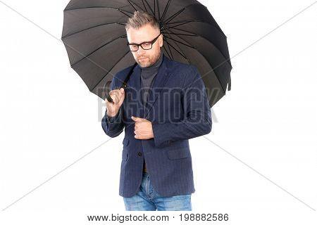 Portrait of elegant middle-aged man holding open black umbrella