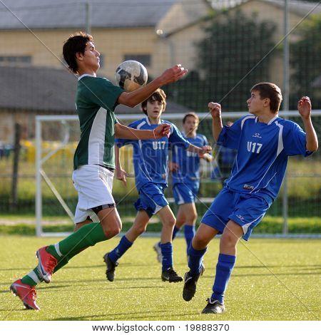 KAPOSVAR, HUNGARY - SEPTEMBER 29: Bence Kovacs (in green) in action at the Hungarian National Championship under 17 game between Kaposvari Rakoczi and Komlo September 29, 2010 in Kaposvar, Hungary.