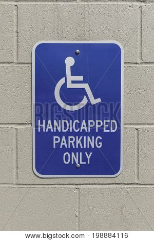 Vertical shot of a handicap sign on a wall