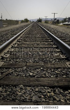 Railroad tracks that are old and wooden