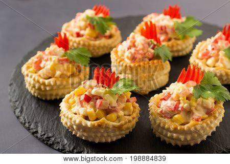Vol-au-vent with chicken salad sweet pepper egg and corn. Festive appetizer for Christmas Valentine's Day Easter. Colorful snack of French cuisine from puff pastry with filling. Selective focus