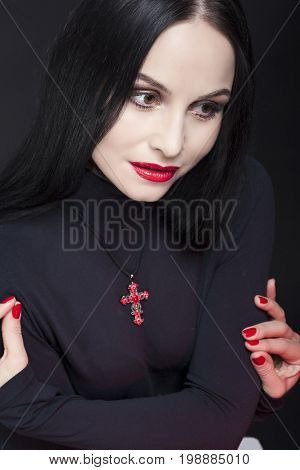 Beauty Concepts and Ideas. Closeup Portrait of Sensual Mid-Aged Caucasian Brunette Woman Posing in Studio in Black Body Suit Against Black. Vertical Image