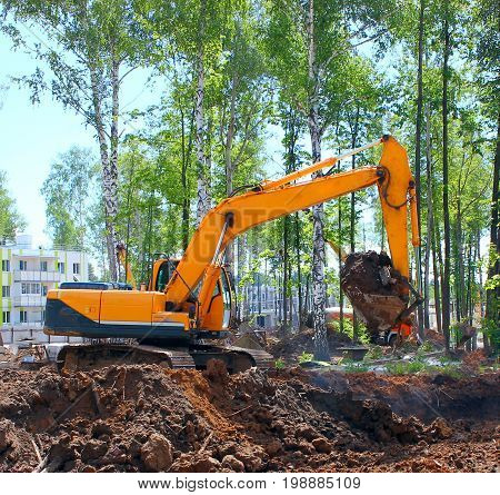 Industrial excavator, bulldozer or heavy machinery working on construction site