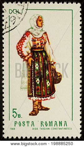 Moscow Russia - August 08 2017: A stamp printed in Romania shows young woman in Romanian national costume Dolj county series